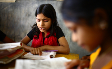 10 Years Old Dipa And 12 Years Old Laboni Study In Class 2 At  Unique Child Learning Center  Mirmur Dhaka Bangladesh 1